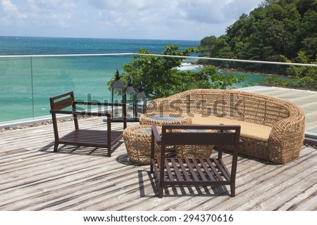 Rattan sofa with the sea view in a luxury resort  - stock photo