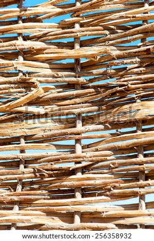 Rattan wattled wicker pattern. Twigged textured fence. Outdoors close-up. - stock photo