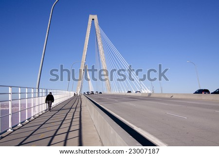 ravenel bridge in charleston, sc, with pedestrians and traffic - stock photo