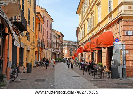RAVENNA, ITALY- APRIL 29, 2015: tourists shopping in a typical downtown street. The city has 3 million tourists per year.