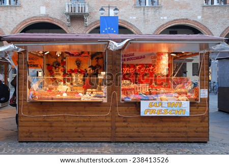 RAVENNA, ITALY-DECEMBER 12, 2014: typical delicatessen stand at the Christmas open market in People square. The market is very popular and attract thousands of people. - stock photo