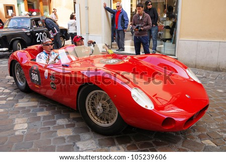 "RAVENNA, ITALY - MAY 18:  A MASERATI 200SI (1957) at the ""Mille miglia"" historical race for classic cars on May 18, 2012 in Ravenna, Italy."