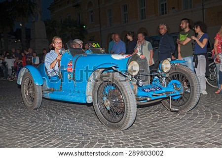 RAVENNA, ITALY - MAY 14: drivers on ancient Italian car Bugatti  T 37  (1926) traveling at night in italian historic race for classic cars Mille Miglia on May 14, 2015 in Ravenna, Italy - stock photo
