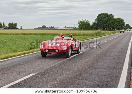RAVENNA, ITALY - MAY 17: unidentified drivers on the old racing car Ferrari 500 Mondial  (1955) in rally Mille Miglia, the famous italian historical race (1927-1957) on May 17, 2013 in Ravenna, Italy