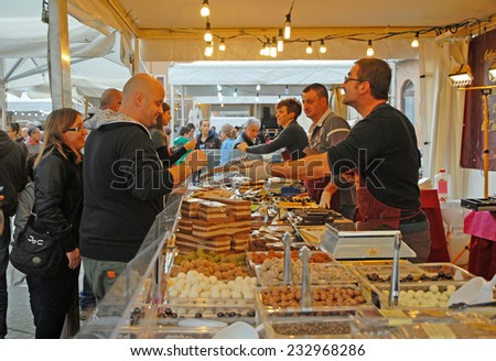RAVENNA, ITALY-NOVEMBER 11, 2014: locals and tourists at the Sunday chocolate market. The place is very popular in the city and attracts thousands of people. - stock photo