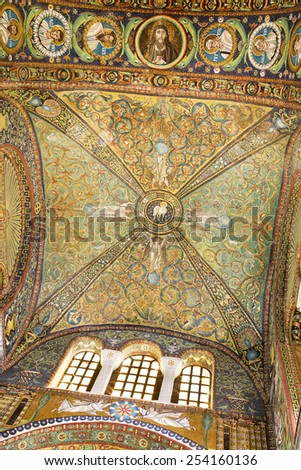RAVENNA, ITALY  SEPTEMBER 6, 2014: Detail of the presbytery vault, richly decorated with mosaics in green, blue and gold, with vine tendrils and small animals.  - stock photo