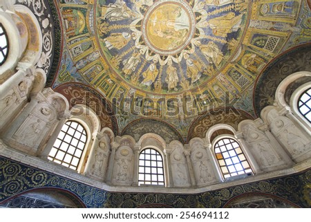 RAVENNA, ITALY -SEPTEMBER 6, 2014: Detail of the windows flanked by niches with stucco decorations and figures of the prophets in Baptistery of Neon in Ravenna, Italy - stock photo