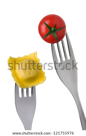 ravioli and cherry tomato on forks against white background - stock photo
