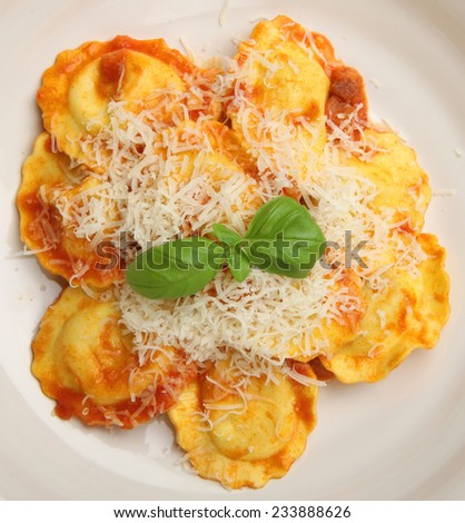 Ravioli in tomato sauce with grated Parmesan cheese. - stock photo