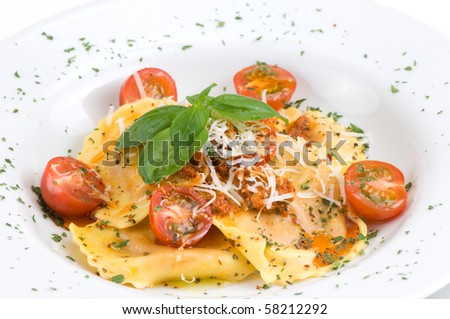 Ravioli with mozzarella cheese, cherry tomatoes and basil