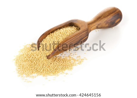 Raw amaranth seeds on wooden scoop over white background