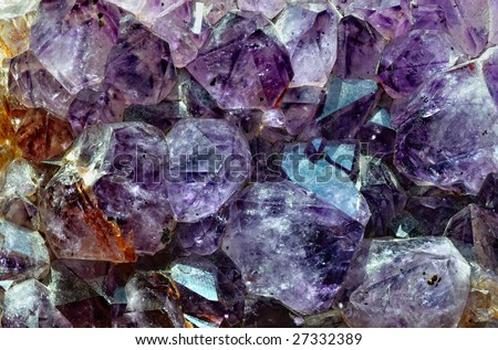 Raw amethyst isolated on white background - stock photo