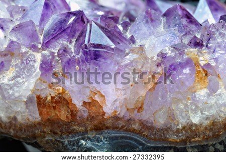 Raw amethyst isolated on white background - stock photo