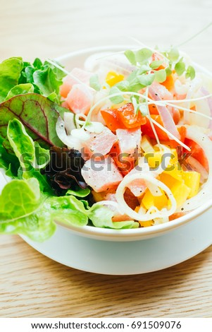 Raw and fresh tuna with vegetable salad in white bowl - Healthy food style , Color Filter Processing