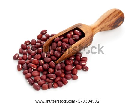 Raw azuki beans on wooden scoop over white background - stock photo