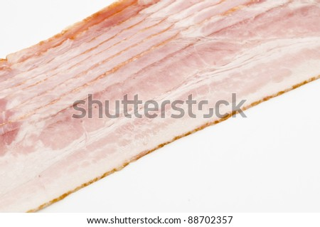 Raw bacon over white background - stock photo