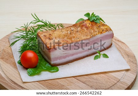 Raw bacon with herbs and spices on wood - stock photo