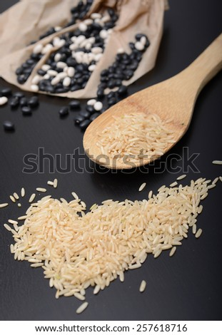 raw beans and rice are a complete protein - stock photo