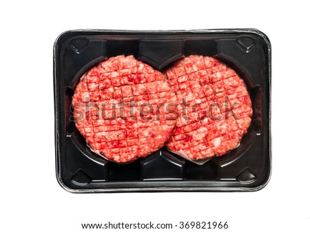 Raw Beef Burgers In A Packaging Tray isolated on white - stock photo