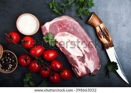 Raw beef meat, beef brisket and ingredients for stew on grey background, top view - stock photo