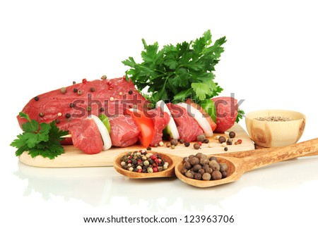 Raw beef meat marinated with herbs and spices isolated on white - stock photo
