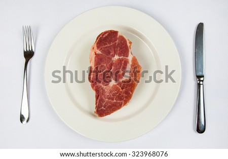 Raw beef meat on a plate. Raw pork meat in a plate on white background. fresh raw meat big piece of steak - stock photo