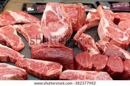 Raw beef on a butcher shop shelf - stock photo