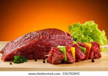 Raw beef on cutting board - stock photo