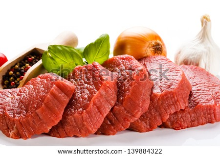 Raw beef on white background - stock photo