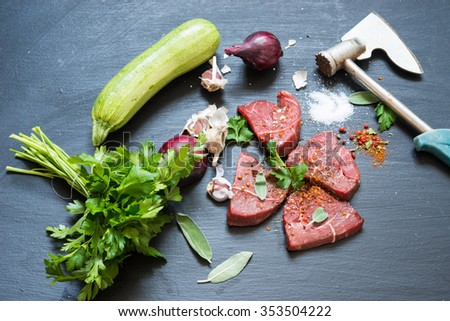 Raw beef steak and vegetables - stock photo