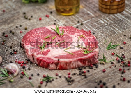 Raw beef steaks. Fresh and beautiful and raw beef fillet on a wooden table. Delicious meat sheep. - stock photo