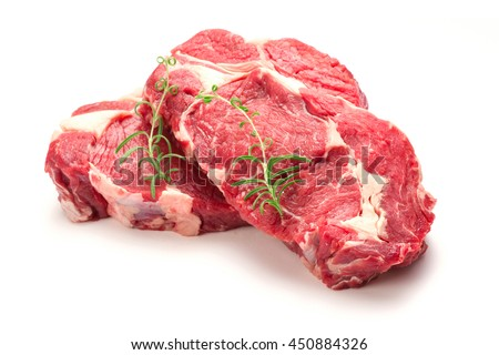 Raw beef steaks isolated on white - stock photo