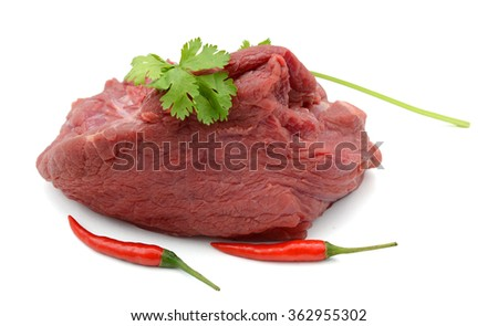 raw beef tenderloin with cilantro and chili peppers isolated on white  - stock photo
