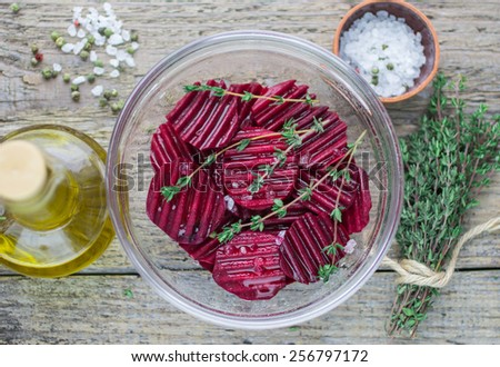 raw beets with olive oil, thyme and sea salt for baking - stock photo