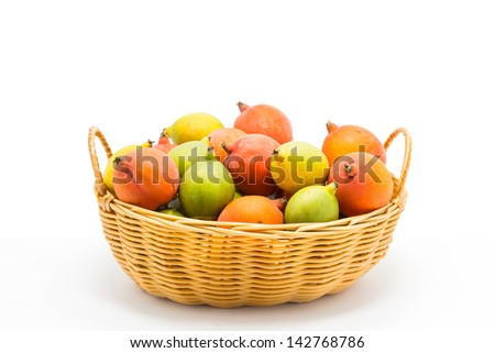 raw betel nut in the basket on white background