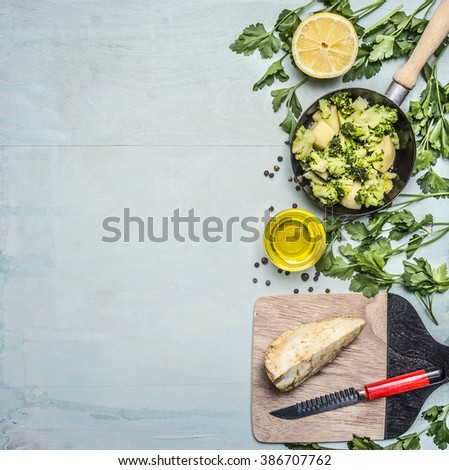 raw broccoli in a pan with herbs, lemon, celery root on a cutting board with a knife border ,place for text on wooden rustic background top view close up - stock photo