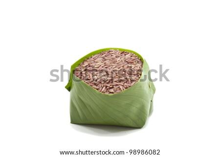 Raw brown rice on white background - stock photo