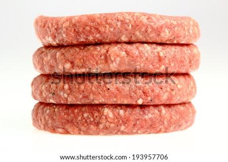 Raw Burger Beef Patty - stock photo