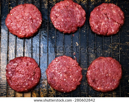 raw burgers from organic beef. top view. style vintage. selective focus - stock photo