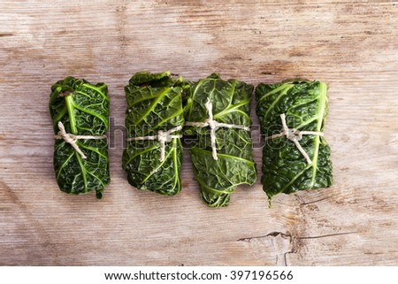 raw cabbage rolls on wood