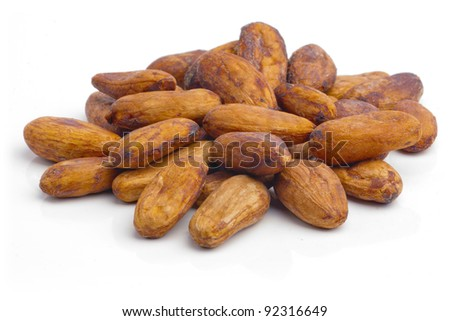 Raw cacao beans isolated on white background - stock photo