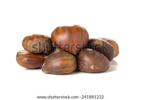 Raw Chestnuts Isolated on a White Background. - stock photo
