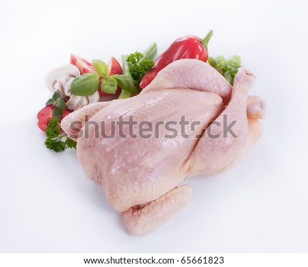 Raw chicken and vegetables  - stock photo