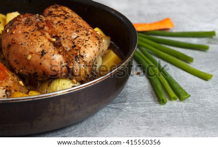 Raw chicken meat in marinade with vegetables in frying pan ready for cooking, close up with selective focus, horizontal view - stock photo