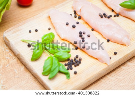 raw chicken pepper and basil