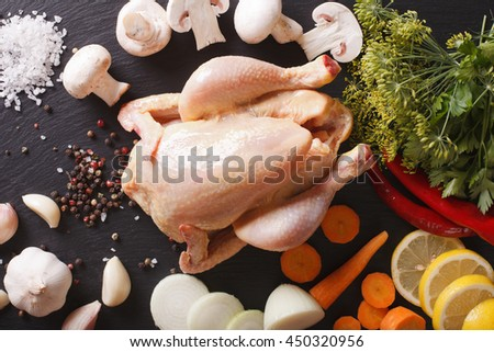 raw chicken with ingredients for cooking broth close-up on the table. horizontal view from above - stock photo