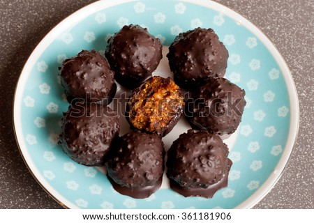 Raw chocolate candy with nuts, figs and citrus, truffle, healthy vegan dessert, top view, close up - stock photo
