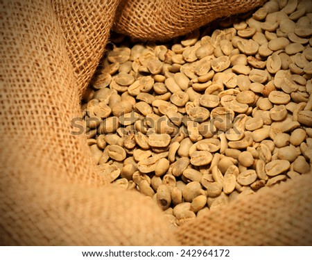 raw coffee beans in a sack, instagram image style - stock photo