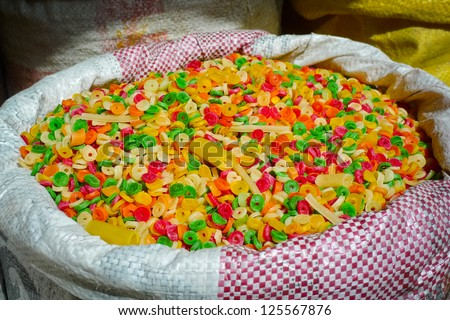 Raw colorful pasta for sale in a market in Bikaner, Rajasthan, India - stock photo