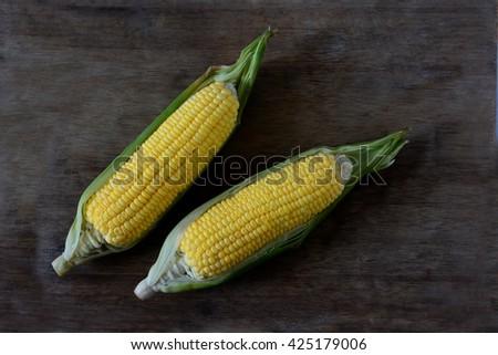 Raw corn, yellow corn, isolated, white background - stock photo